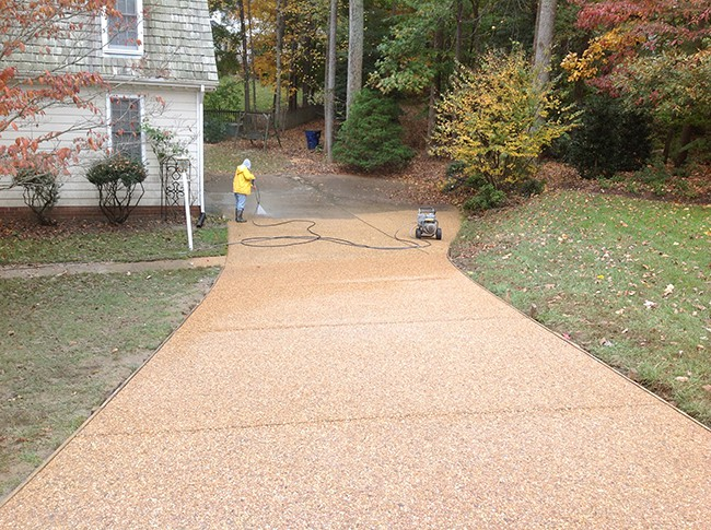 Exp Aggregate driveway half cleaned and sealed